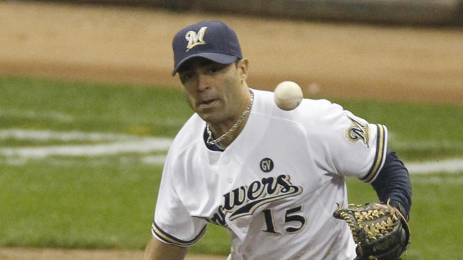 Milwaukee Brewers' Jerry Hairston Jr. can't handle a ball hit by St. Louis Cardinals' Yadier Molina during the fifth inning of Game 6 of baseball's National League championship series Sunday, Oct. 16, 2011, in Milwaukee. (AP Photo/Jeff Roberson)