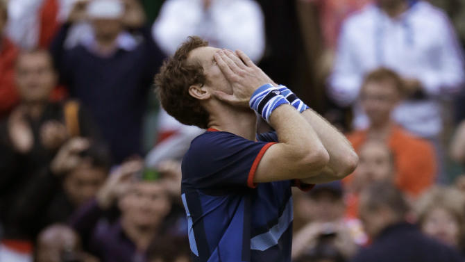 Andy Murray of Great Britain celebrates after defeating Novak Djokovic of Serbia at the All England Lawn Tennis Club at Wimbledon, in London, at the 2012 Summer Olympics, Friday, Aug. 3, 2012. (AP Photo/Mark Humphrey)