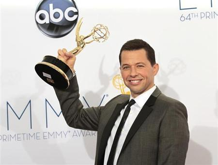"Jon Cryer holds up the award for outstanding lead actor in a comedy series for his role in ""Two and a Half Men"" at the 64th Primetime Emmy Awards in Los Angeles"