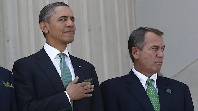 """FILE - In this March 19, 2013 file photo, President Barack Obama stands with House Speaker John Boehner of Ohio after they attended a Friends of Ireland luncheon on Capitol Hill in Washington. The partisan cease-fire that kept the government running this spring gave birth to hopeful talk of a much larger """"grand bargain"""" that would reduce the federal deficit for years. But such optimism seems to ignore how far apart the two parties remain on key issues. The mutual obstinance disappoints those who felt top Republicans and Democrats were close to a major accord on spending cuts and tax increases in December.  (AP Photo/Charles Dharapak. File)"""
