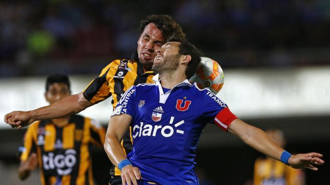 Martelli of Bolivia's The Strongest and Rojas of Chile's Universidad de Chile head a ball during their Copa Libertadores soccer match in Santiago
