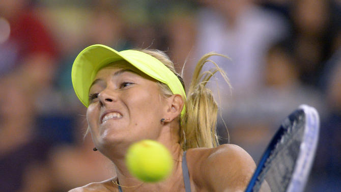 Maria Sharapova, of Russia, returns a shot to Maria Kirilenko, of Russia, during their semifinal match at the BNP Paribas Open tennis tournament, Friday, March 15, 2013, in Indian Wells, Calif. (AP Photo/Mark J. Terrill)