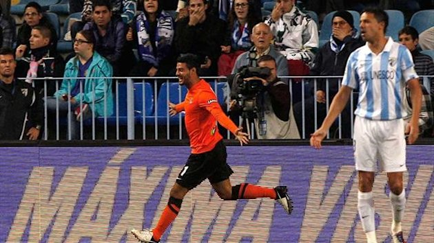 Real Sociedad&#39;s Carlos Vela celebrates after opening the scoring in the first minute against Malaga.