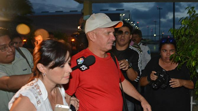 Venezuela's ex-military intelligence chief, Hugo Carvajal, arrives at the Queen Beatrix International Airport after he was released by authorities, in Oranjestad, Aruba, Sunday, July 27, 2014. Carvajal, who was designated to be Venezuela's consul to Aruba, was detained at the Caribbean island's airport on a request from U.S. prosecutors. U.S. authorities alleged Carvajal is one of several high-ranking Venezuelan military and law enforcement officials who provided haven to drug traffickers from neighboring Colombia and helped them move U.S.-bound cocaine through Venezuela. (AP Photo/Pedro Famous Diaz)