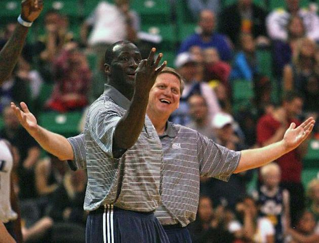 Jazz head coach Tyrone Corbin, left, teases the losing team for their three point loss.  Utah Jazz fans filled  EnergySolutions Arena Saturday to get a glimpse at this year's players during the annual