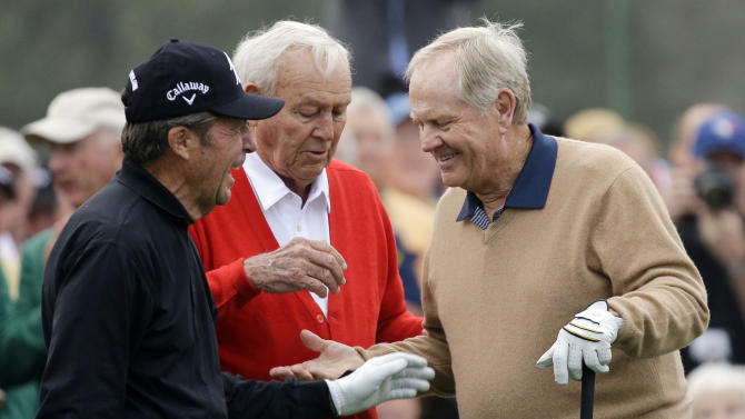 From left, honorary starters Gary Player, Arnold Palmer and Jack Nicklaus chat after hitting on the first tee during the first round of the Masters golf tournament Thursday, April 11, 2013, in Augusta, Ga. (AP Photo/David J. Phillip)