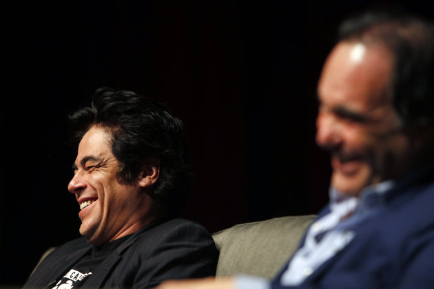 "Puerto Rican actor Benicio Del Toro, left, and film director Oliver Stone give a conference with students at the University of Puerto Rico in San Juan, Friday, Nov. 30, 2012. Del Toro didn't wait long to collect on a favor that Stone owed him for working extra hours on the set of his most recent movie, ""Savages"", released this year: a trip to his native Puerto Rico, which Stone hadn't visited since the early 1960s. Both are in the U.S. Caribbean territory to raise money for the Art Museum of Puerto Rico, which is hosting its annual movie festival and will honor Stone's movies. (AP Photo/Ricardo Arduengo)"