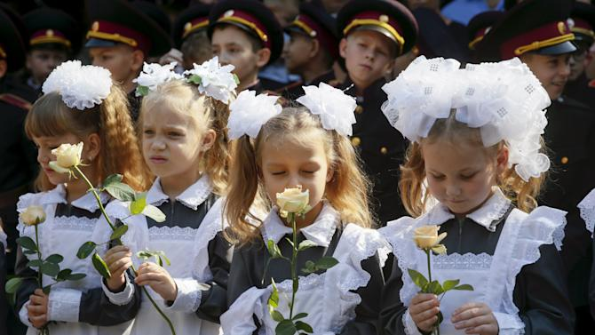 First graders of cadet's lyceum hold flowers as they attend ceremony to mark start of new school year in Kiev