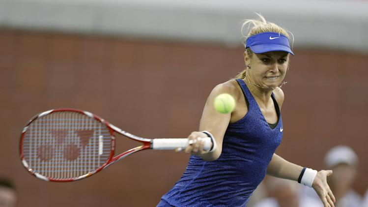 Sabine Lisicki, of Germany, returns a shot to Madison Brengle, of the United States, during the second round of the U.S. Open tennis tournament Wednesday, Aug. 27, 2014, in New York. (AP Photo/Darron Cummings)