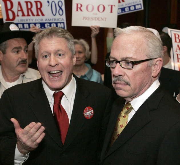 In this Sunday, May 25, 2008 photo, Wayne Allyn Root and former Republican congressman Bob Barr talk to their supporters for the Libertarian Presidential nomination after Root gave his support for Bar