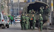 File photo of Chinese soldiers in the Tibetan capital Lhasa. Hundreds of people have been detained in Lhasa after two men set themselves on fire in the Tibetan regional capital on Sunday in protest against Chinese rule, a US-based broadcaster reported
