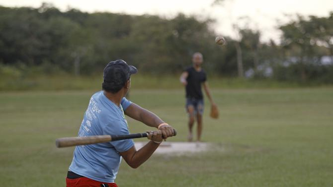 Cuban migrants play baseball in La Cruz, Costa Rica