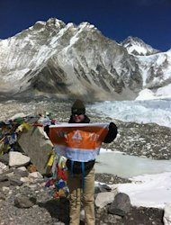 US teenager Eli Reimer poses at Everest Base Camp in the shadow of Mount Everest, April 3, 2013. Reimer, who suffers from Down's Syndrome, reached the 5,364-metres (17,500 foot) high camp in Nepal's Himalayan mountains in mid-March after 10 days of trekking