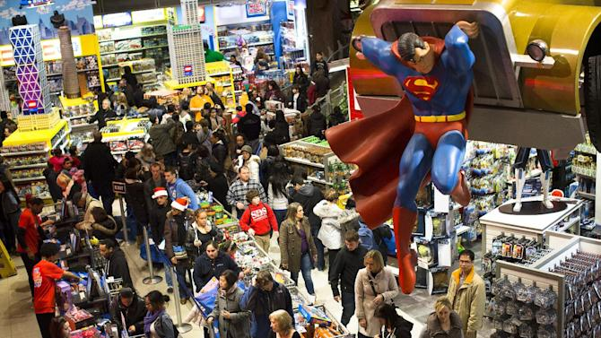 Shoppers wait on a check-out line in the Times Square Toys-R-Us store after doors were opened to the public at 8 p.m. on Thursday, Nov. 22, 2012, in New York. While stores typically open in the wee hours of the morning on the day after Thanksgiving known as Black Friday, openings have crept earlier and earlier over the past few years. Now, stores from Wal-Mart to Toys R Us are opening their doors on Thanksgiving evening, hoping Americans will be willing to shop soon after they finish their pumpkin pie. (AP Photo/John Minchillo)