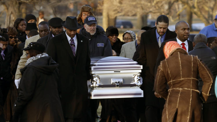 The remains of Hadiya Pendleton are taken to her final resting place at the Cedar Park Cemetery Saturday, Feb. 9, 2013, in Calumet Park, Ill. Pendleton was killed on Jan. 29, when a gunman opened fire on her and some friends seeking shelter in a park from the rain about a mile from President Obama's Chicago home. First lady Michelle Obama attended the funeral with Senior White House Adviser Valerie Jarrett and Secretary of Education Arne Duncan. (AP Photo/Charles Rex Arbogast)
