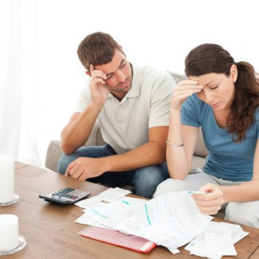 Stressed-couple-doing-paperwork_web