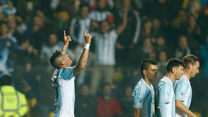 Argentina's Marcos Rojo , left, celebrates after scoring the opening goal during a Copa America semifinal soccer match against Paraguay at the Ester Roa Rebolledo Stadium in Concepcion, Chile, Tuesday, June 30, 2015. (AP Photo/Andre Penner)