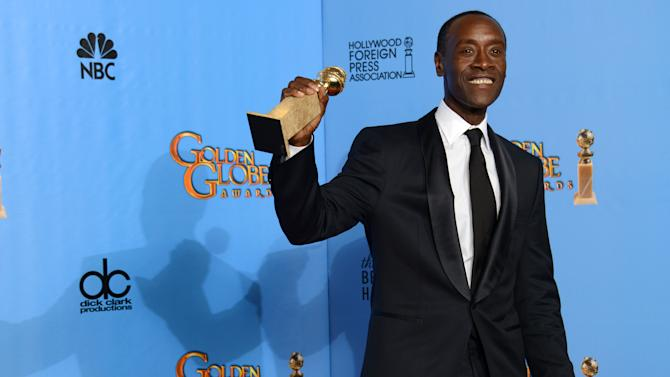 """Actor Don Cheadle poses with the award for best performance by an actor in a television series - comedy or musical for """"House of Lies"""" backstage at the 70th Annual Golden Globe Awards at the Beverly Hilton Hotel on Sunday Jan. 13, 2013, in Beverly Hills, Calif. (Photo by Jordan Strauss/Invision/AP)"""