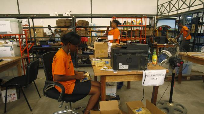 Employees prepare goods for customers at the stockroom of Jumia office in Abidjan