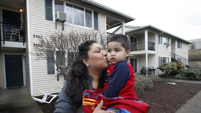 In this Feb. 28, 2012 photo, Madeline Hutchinson kisses her son Emmanuel outside their home in Salem, Ore. Pregnant with her seventh child and desperate to kick a methamphetamine habit, Hutchinson turned to a program from the local Medicaid provider that connected her with a mentor and other support that helped her stay off drugs and give birth to a healthy boy.  Emmanuel, now 2, was born drug-free and is the only one of her children still in her custody. But Hutchinson's health provider can't get reimbursed for much of the treatment she credits with saving her life, keeping her healthy and protecting the health of her child. (AP Photo/Rick Bowmer)