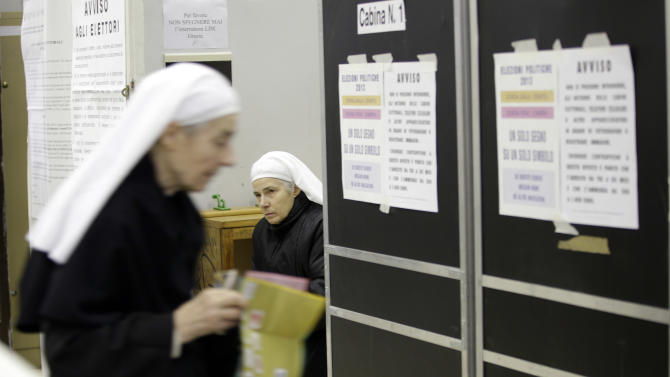 Nuns vote in a polling station in downtown Rome, Sunday, Feb. 24, 2013. Italy votes in a watershed parliamentary election Sunday and Monday that could shape the future of one of Europe's biggest economies. (AP Photo/Andrew Medichini)