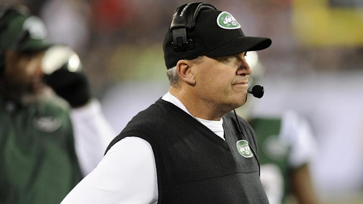 New York Jets head coach Rex Ryan reacts after quarterback Mark Sanchez fumbled and New England Patriots' Steve Gregory returned it for a touchdown during the first half of an NFL football game on Thursday, Nov. 22, 2012, in East Rutherford, N.J. (AP Photo/Bill Kostroun)
