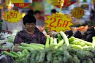 Chinese shoppers buy vegetables at a supermarket in Hefei, east China's Anhui province, on August 9. China's leaders will have more room to further loosen monetary policy after data Thursday showed inflation at its lowest in two and a half years while industrial output and retail sales also eased