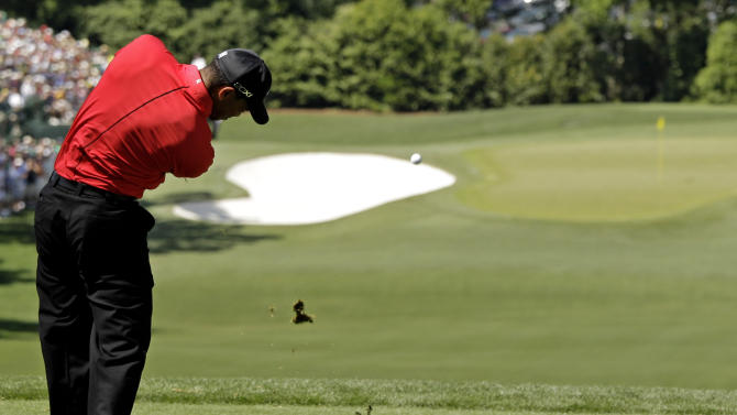 Tiger Woods tees off on the fourth hole during the fourth round of the Masters golf tournament Sunday, April 8, 2012, in Augusta, Ga. (AP Photo/Charlie Riedel)