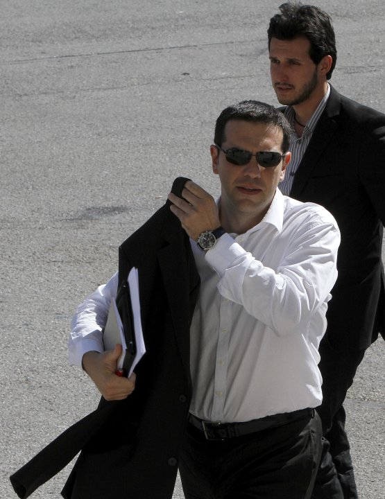 Head of Greece's radical left-wing Syriza party Alexis Tsipras arrives at Zappeio Conference Hall following his statement  in Athens, Tuesday, June 12, 2012. Tsipras, whose party came a surprise secon
