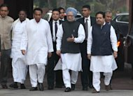 Indian Prime Minister, Manmohan Singh (C), arrives at the Parliament House to attend a session, in New Delhi, on November 22, 2012. Singh on Thursday urged lawmakers to engage in 'responsible' debate as the government seeks to push the annual budget and controversial economic reforms to spur the economy through parliament