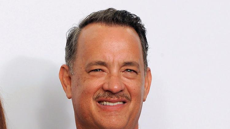 "FILE - This Sept. 23, 2012 file photo shows Tom Hanks backstage at the 64th Primetime Emmy Awards at the Nokia Theatre in Los Angeles. Hanks' Broadway debut will include an old buddy _ former ""Bosom Buddies"" co-star Peter Scolari will share the stage with the Oscar winner. Producers revealed the rest of the cast to appear with Hanks in Nora Ephron's play ""Lucky Guy,"" which begins previews March 1 at the Broadhurst Theatre. (Photo by Jordan Strauss/Invision/AP, file)"