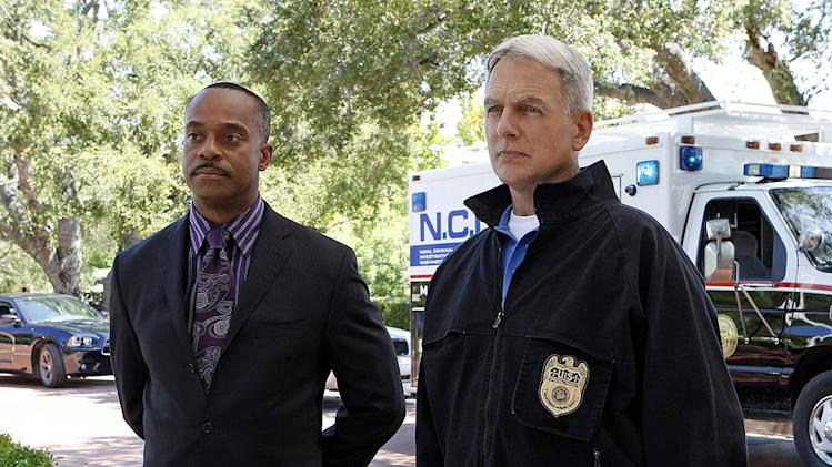 """Nature of the Beast"" -- After spending months tracking down his target, Tony is left with the blood of an NCIS agent on his hands and it's up to Gibbs (Mark Harmon, right)  to help him put the pieces of the puzzle together, on the ninth season premiere of NCIS, Tuesday, Sept. 20 (8:00-9:00 PM, ET/PT) on the CBS Television Network. Also pictured: Rocky Carroll, left  Photo: Sonja Flemming/CBS ©2011 CBS Broadcasting Inc. All Rights Reserved NCIS"
