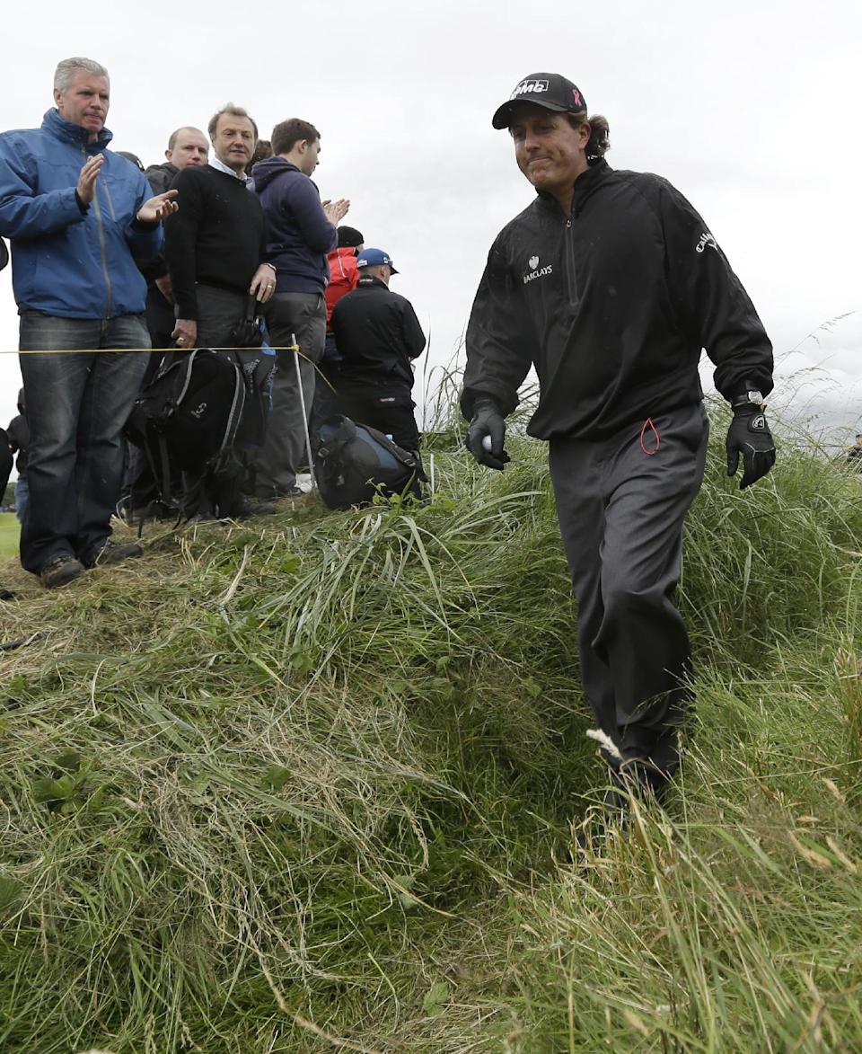 Phil Mickelson of the United States walks from the 13th green at Royal Lytham & St Annes golf club during the first round of the British Open Golf Championship, Lytham St Annes, England, Thursday, July 19, 2012. (AP Photo/Jon Super)