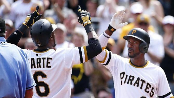 Pittsburgh Pirates' Starling Marte (6) is greeted by teammate Andrew McCutchen (22) after hitting a three-run home run off New York Mets relief pitcher Erik Goeddel in the sixth inning of a baseball game in Pittsburgh, Sunday, May 24, 2015. (AP Photo/Gene J. Puskar)
