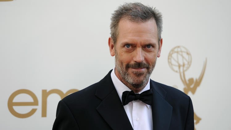"FILE - In this Sept. 18, 2011 file photo, actor Hugh Laurie arrives at the 63rd Primetime Emmy Awards in Los Angeles. Laurie was nominated for an Emmy for best actor for his role in ""House.""  (AP Photo/Chris Pizzello, file)"