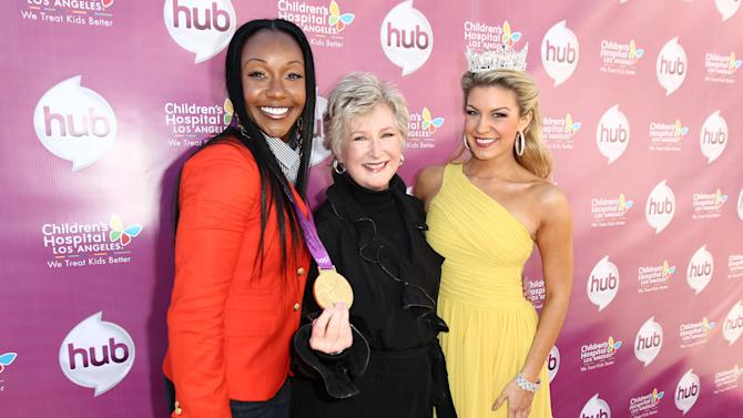 """IMAGE DISTRIBUTED FOR THE HUB - From left, Carmelita Jeter, Margaret Loesch, president and CEO of The Hub TV Network, and Miss America 2013 Mallory Hagan attend The Hub TV Network's """"My Little Pony Friendship is Magic"""" Coronation Concert at the Brentwood Theatre on Saturday, Feb. 9, 2013, in Los Angeles in support of Children's Hospital LA. (Photo by Matt Sayles/Invision for The Hub/AP Images)"""