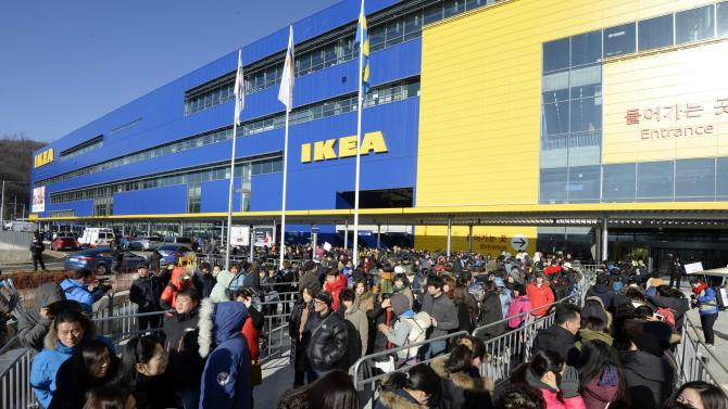 Visitors queue to enter an IKEA store in Gwangmyeong