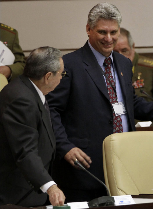 Cuba's new Vice President Miguel Diaz-Canel, right, smiles at Cuba's President Raul Castro, during the closing session at the National Assemby in Havana, Cuba, Sunday, Feb. 24, 2012. Castro accepted a