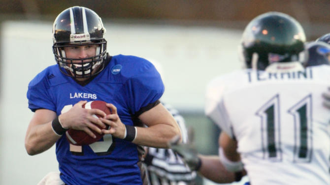 FILE - In this Dec. 10, 2005, file photo, Grand Valley State quarterback Cullen Finnerty runs against Northwest Missouri State's Chris Termini during the first half of the NCAA Division II championship football game in Florence, Ala. Authorities say the former college football quarterback who went missing over the weekend has been found dead in Michigan.  Lake County Undersheriff Dennis Robinson says Finnerty's body was found Tuesday night, May 28, 2013. (AP Photo/Rainier Ehrhardt, File)