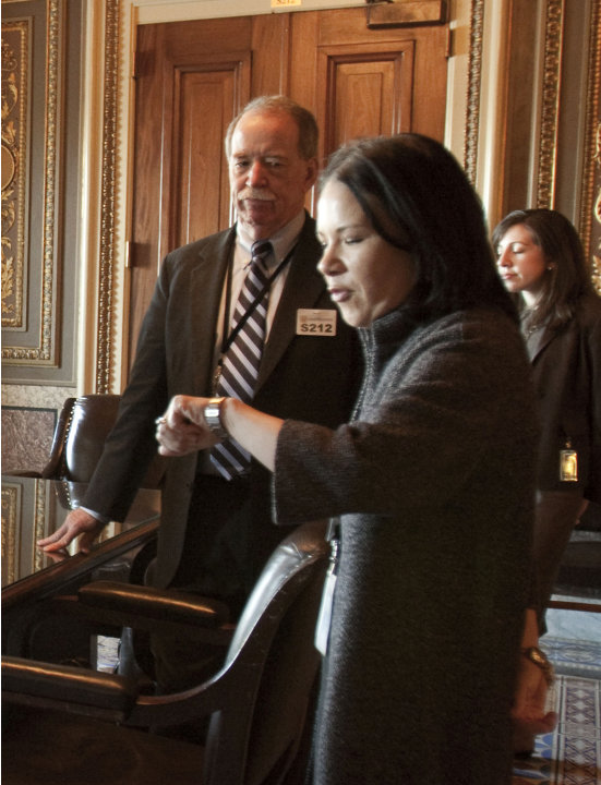 FILE - In this Dec. 23, 2009 file photo, Michael Hash of HHS, left, and White House health reform director Nancy-Ann DeParle, are seen on Capitol Hill in Washington. Republican governors who've balked