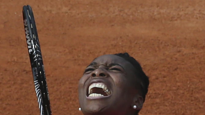 Venus Williams of the U.S. screams after missing a return a return against Poland's Urszula Radwanska in their first round match of the French Open tennis tournament, at Roland Garros stadium in Paris, Sunday, May 26, 2013. (AP Photo/Michel Euler)