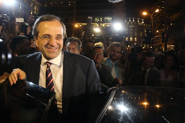 Leader of the New Democracy conservative party Antonis Samaras leaves an elections kiosk after speaking to his supporters at Syntagma square in Athens, Sunday, June 17, 2012. The pro-bailout New Democracy party came in first Sunday in Greece's national election, and its leader has proposed forming a pro-euro coalition government. (AP Photo/Petros Karadjias)