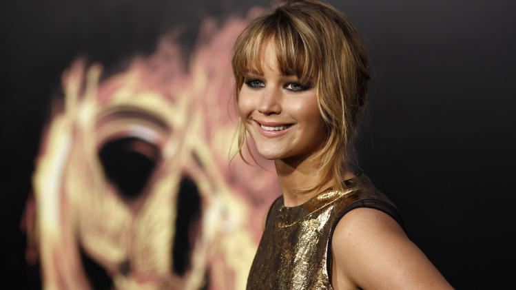 "Jennifer Lawrence arrives at the world premiere of ""The Hunger Games"" on Monday March 12, 2012 in Los Angeles. (AP Photo/Matt Sayles)"