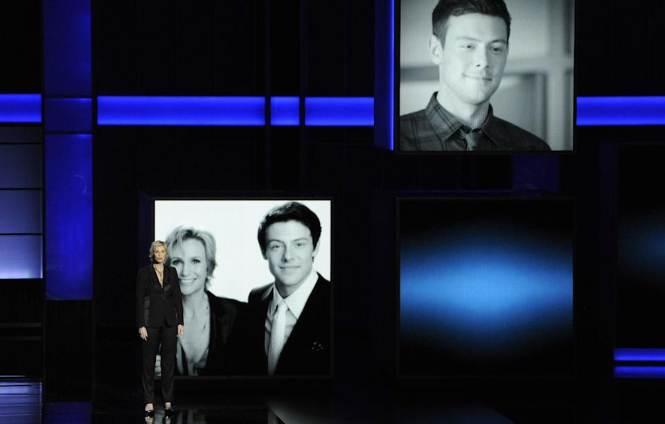 Jane Lynch presents a tribute to Cory Monteith on stage at the 65th Primetime Emmy Awards at Nokia Theatre on Sunday Sept. 22, 2013, in Los Angeles. Monteith died on July 13. (Photo by Chris Pizzello/Invision/AP)