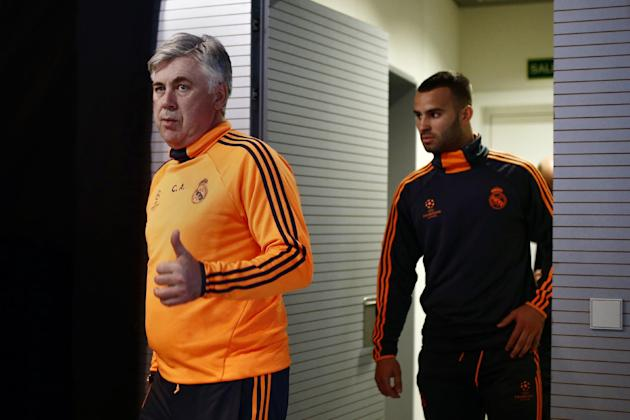 Real Madrid's head coach Carlo Ancelotti, left, and Jese Rodriguez, right, arrive during the press conference prior to the Champions League second leg knock out soccer match between FC Schalke 04