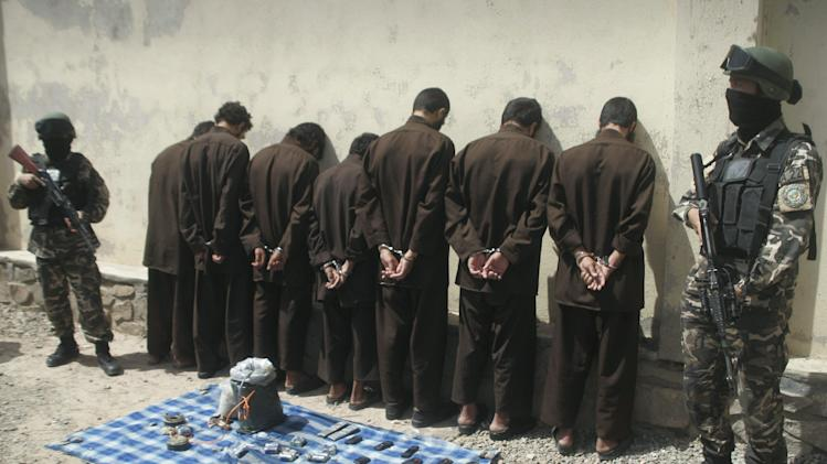 Seven suspected Taliban insurgents are shown to the media in Herat, west of Kabul, Afghanistan, Wednesday, June 20, 2012. Afghan intelligence security forces arrested seven suspected Taliban insurgents on Tuesday with their explosive materials during an operation.(AP Photo/Hoshang Hashimi)