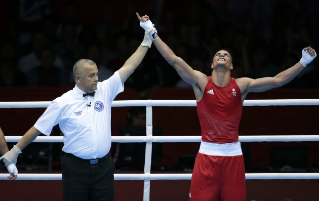 Great Britain's Anthony Ogogo reacts after defeating Dominican Republic's Junior Castillo Martinez during a men's bantam 75-kg preliminary boxing match at the 2012 Summer Olympics, Saturday, July 28, 2012, in London. (AP Photo/Ivan Sekretarev)