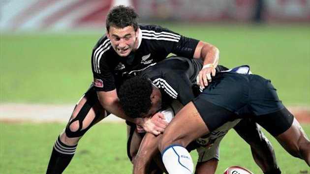 New Zealand's Kurt Baker and Tomasi Cama fight for the ball (Reuters)