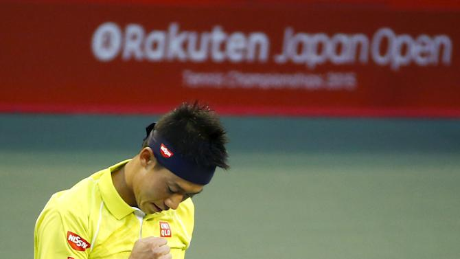 Japan's Kei Nishikori reacts after defeating Marin Cilic of Croatia during their men's singles tennis match at the Japan Open championships in Tokyo