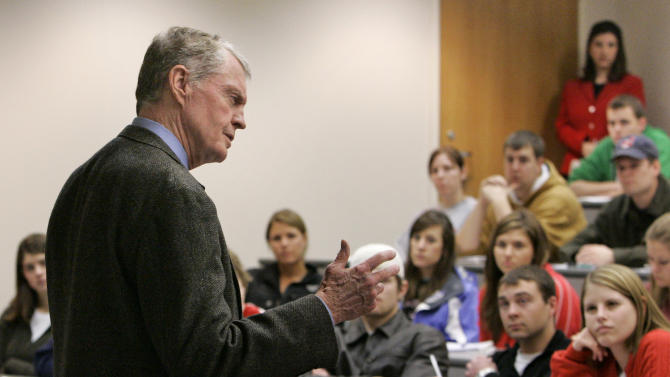 FILE - In this Tuesday, Jan. 9, 2007 file photo, former Nebraska coach and Congressman Tom Osborne teaches a class at the College of Business Administration at the University of Nebraska-Lincoln, in Lincoln, Neb. Osborne will retire as Nebraska's athletic director on Jan. 1, 2013, and end an association with the university that began in 1962. (AP Photo/Nati Harnik, File)